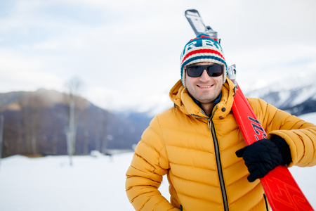 Picture of sporty man with mountain skis