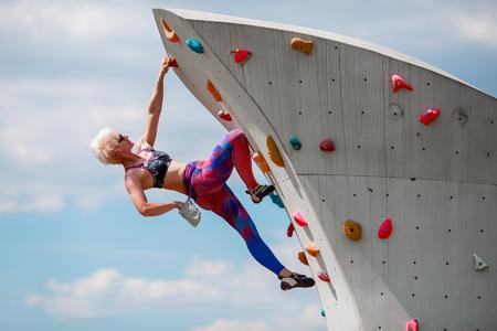 Photo of sportswoman on workout on climbing wall Stock Photo