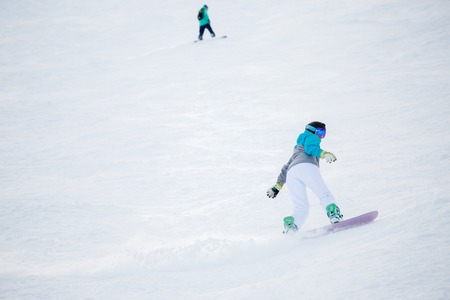 Photo of woman athlete riding snowboard