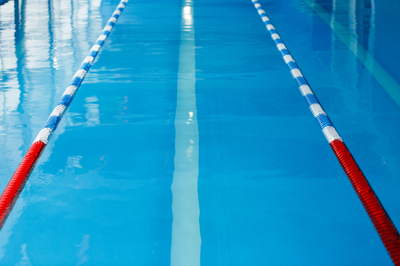 Image from top of swimming pool with blue and white, red dividers