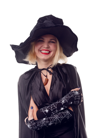 Witch blonde in black hat with arms crossed