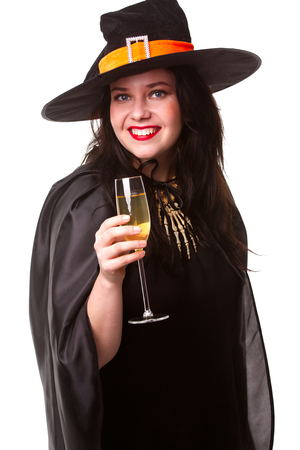 Image of witty brunette in black hat with glass of champagne