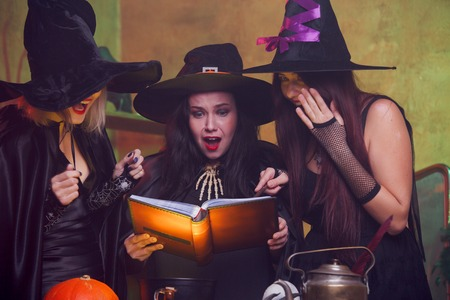 Picture of three witches with book in hands