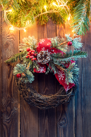Christmas wreath on a rustic wooden door.