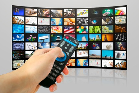 TV with pictures of smart television and mans hands with remote control,close up.