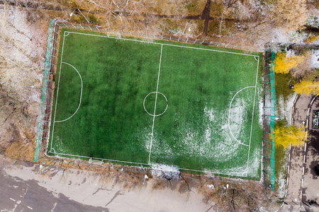 Photo from above of soccer field with snow. Stock Photo