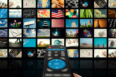 TV set with pictures of smart television and remote control,close up.
