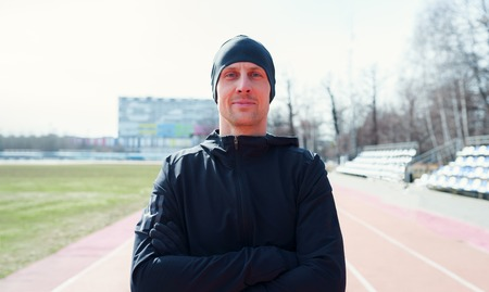 Photo of sporty man on street at stadium