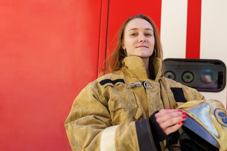Image of fire girl standing at fire truck