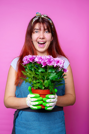 Photo of cheerful woman with chrysanthemums Stock Photo
