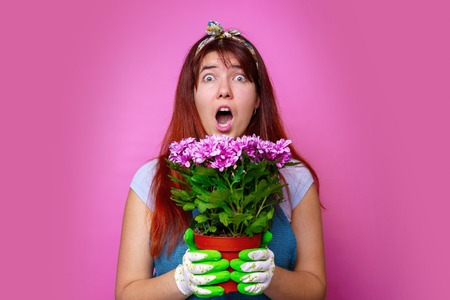 Image of surprised woman with chrysanthemums