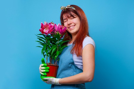 Portrait of surprised brunette girl with chrysanthemums