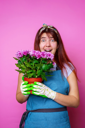 Photo of surprised woman with chrysanthemums 스톡 콘텐츠