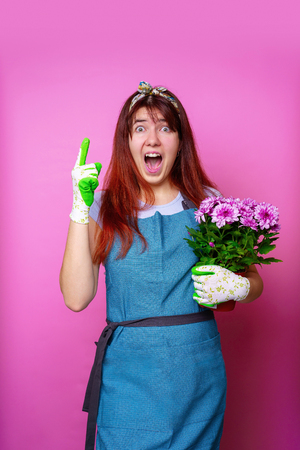 Photo of cheerful girl with chrysanthemum pointing hand up 스톡 콘텐츠