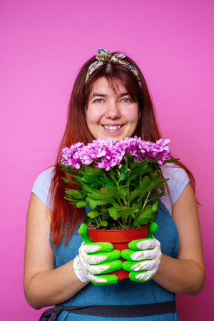 Image of cheerful woman with chrysanthemums