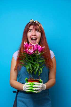 Photo of screaming brunette woman with lilies