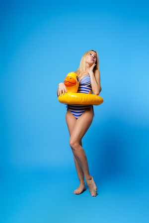 Image of blonde in swimsuit with lifebuoy Stock Photo