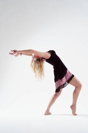 Photo of young blonde dancing in empty studio