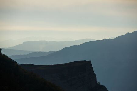 Image of foggy mountain landskape at sunset Banco de Imagens - 132109842