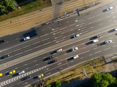 Photo from above of asphalt road and riding cars