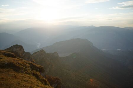 Image of picturesque mountain landscape, foggy sky in summer Banco de Imagens
