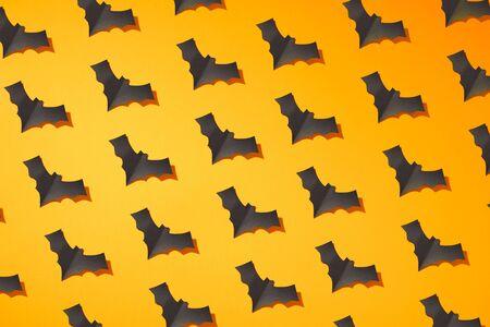Halloween photo of black bats on blank orange background Reklamní fotografie