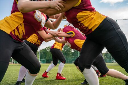 Photo of athletes women playing american football on green lawn