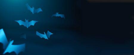 Halloween photo of blue paper bats on blank dark blue background. Stock Photo