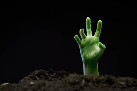 Photo of zombie hand sticking out of grave. Stock Photo