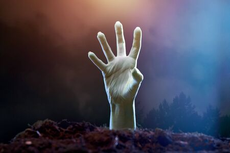 Image of zombie hand sticking out of grave