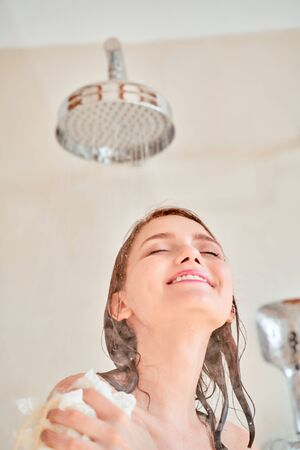 Picture of happy girl taking shower .