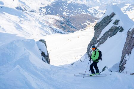 Athletic men skiing on snowy slope on winter afternoon