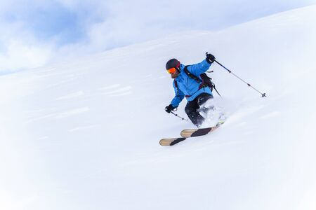 Photo of sportsman with beard skiing in winter resort