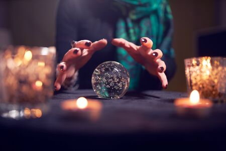 Close-up of fortune-tellers hands with ball of predictions Reklamní fotografie