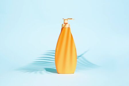 Orange container for lotion without label on turquoise background