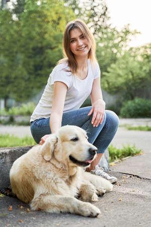 Happy woman on walk with labrador on summer 版權商用圖片