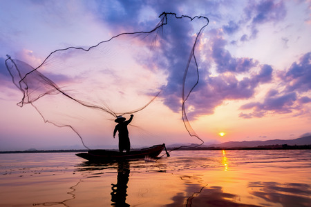 entrapment: Fisherman of Bangpra Lake in action when fishing Thailand