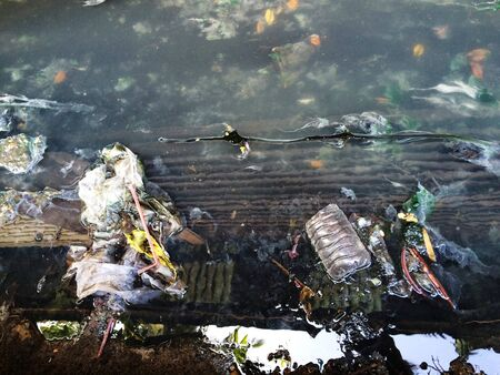 water contamination: Water pollution from household trash waste