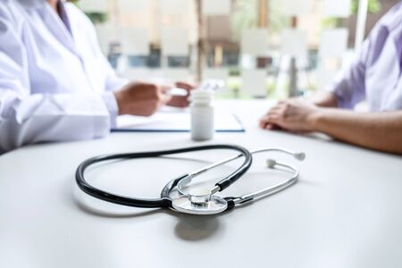 Doctor and patient are discussing consultation about symptom problem diagnosis of disease talk to the patient about medication and treatment method.