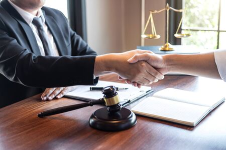 Handshake after good deal negotiation cooperation, Professional male lawyer or counselor and client meeting, working with legal case document contract in office, law and justice, attorney, lawsuit.