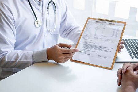 Doctor presenting with patient and checking results on report and prescription about the problem of illness and recommend using medicine, healthcare and medical concept.