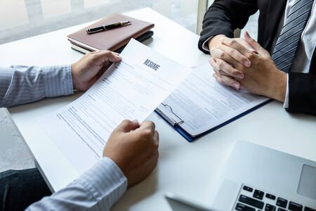 Businessman interview consider a resume conversation during about profile of candidate of conducting a job interview listen to answers while sitting at the working meeting in office.