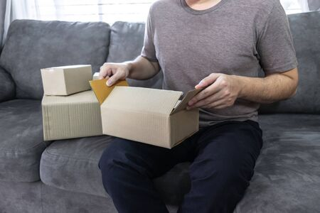 Young entrepreneur business owner work at home, small business startup receive order client and take note working with report and pack the product on purchase delivery online.