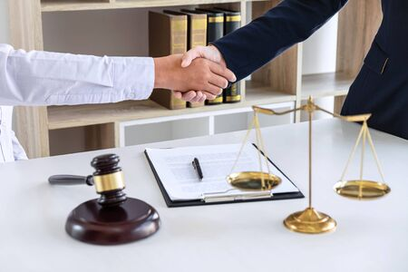 Handshake after good deal negotiation cooperation, Professional female lawyer or counselor and client meeting, working with legal case document contract in office, law and justice, attorney, lawsuit.