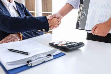 Good deal of interview, Business committee and recruiter shaking hands greeting or get acquainted of conducting a job interview while sitting at the working meeting in office.