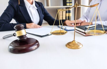 Professional female lawyer or counselor discussing negotiation legal case with client meeting with document contract in office, law and justice, attorney, lawsuit concept.