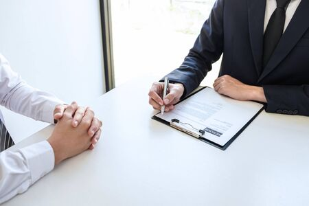 Business committee or interviewer consider and asking about profile of candidate, consider resume conducting a job and conversation listen to answers to thought attitude.