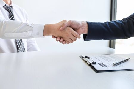 Good deal of interview, Business people and recruiter shaking hands greeting or get acquainted of conducting a job interview while sitting at the working meeting in office.
