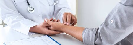 Doctor checking measuring pressure on patient's hand pulse by hands, Medical and healthcare concept.