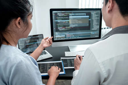 Team of Developer programmer working on coding program software computer in office, Writing website and development database technology.